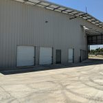 Prefab steel roof with parking overhang at self-storage building