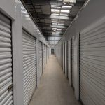 Self storage facility hallways with rollup doors